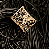 Melania Crocco : Phoenix bracialet with diamonds in rose and black gold 18 kt