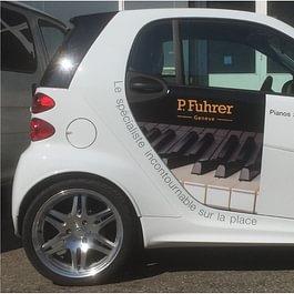 Déco pub sur voiture SMART. Impression numérique  et découpe adhésive des stickers.