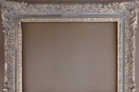 A wood carved Louis XV style frame