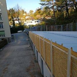 Réalisation d'une couverture en pente sur garage existant, avec de la tôle isolée, à Yverdon