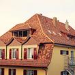 Biberschwanzziegeldach Sanierung inkl. Wärmedämmung, Unterdach, Dachfester und Umbau einer Lukarne zu einer Loggia.