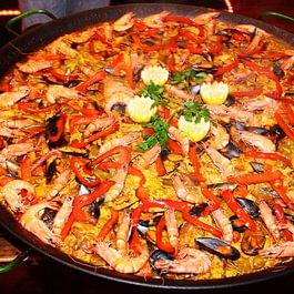 Paella, das spanische Original. Ideal für Events und Caterings. Werden vor Ort zubereitet.
