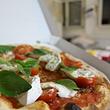 probieren Sie unsere hausgemachten Pizza's