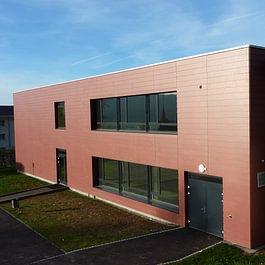 Rénovation de façade en Eternit rouge