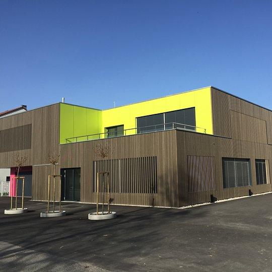 Réalisation des revêtements de façade complet à l'école d'Yvonand
