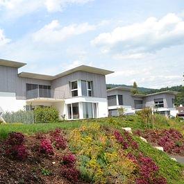 Construction de 3 villas, façade bois grisé
