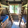 Chambre à coucher avec 4 lits