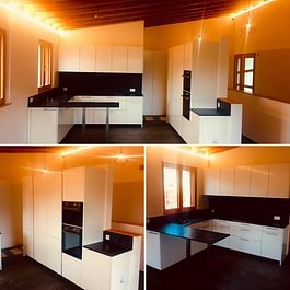 Cucina bianca lucida con piani di lavoro il pietra naturale