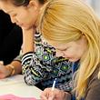 Konzentriertes Lernen im Deutschkurs bei ECAP Bern