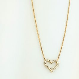 Collier coeur en or jaune et diamants