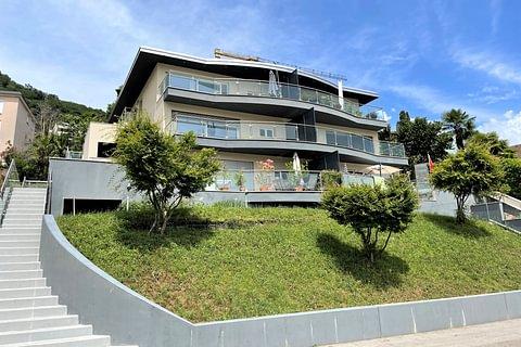 Ponte Tresa (CH) - Moderne und helle 4,5-Zimmer-Wohnung mit Garden zum Verkauf
