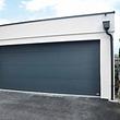 Porte de garage sectionnel automatiser posé par ABC forgeron Sarl