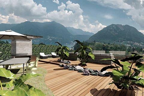 Attico di 3.5 loc. vista lago e terrazzo sul tetto.