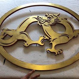 Blattvergoldetes Drachenlogo Rahmenatelier Maschera d`Oro