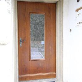 Porte d'entrée plaquée chêne
