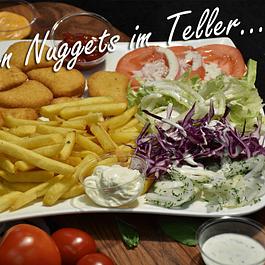 Chicken Nuggets im Teller oder als Box